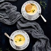 Two teacups and saucers with lemon possets inside