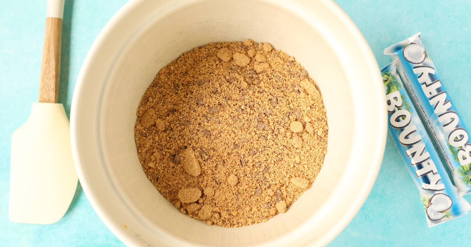 A bowl filled with chocolate digestive biscuit crumbs