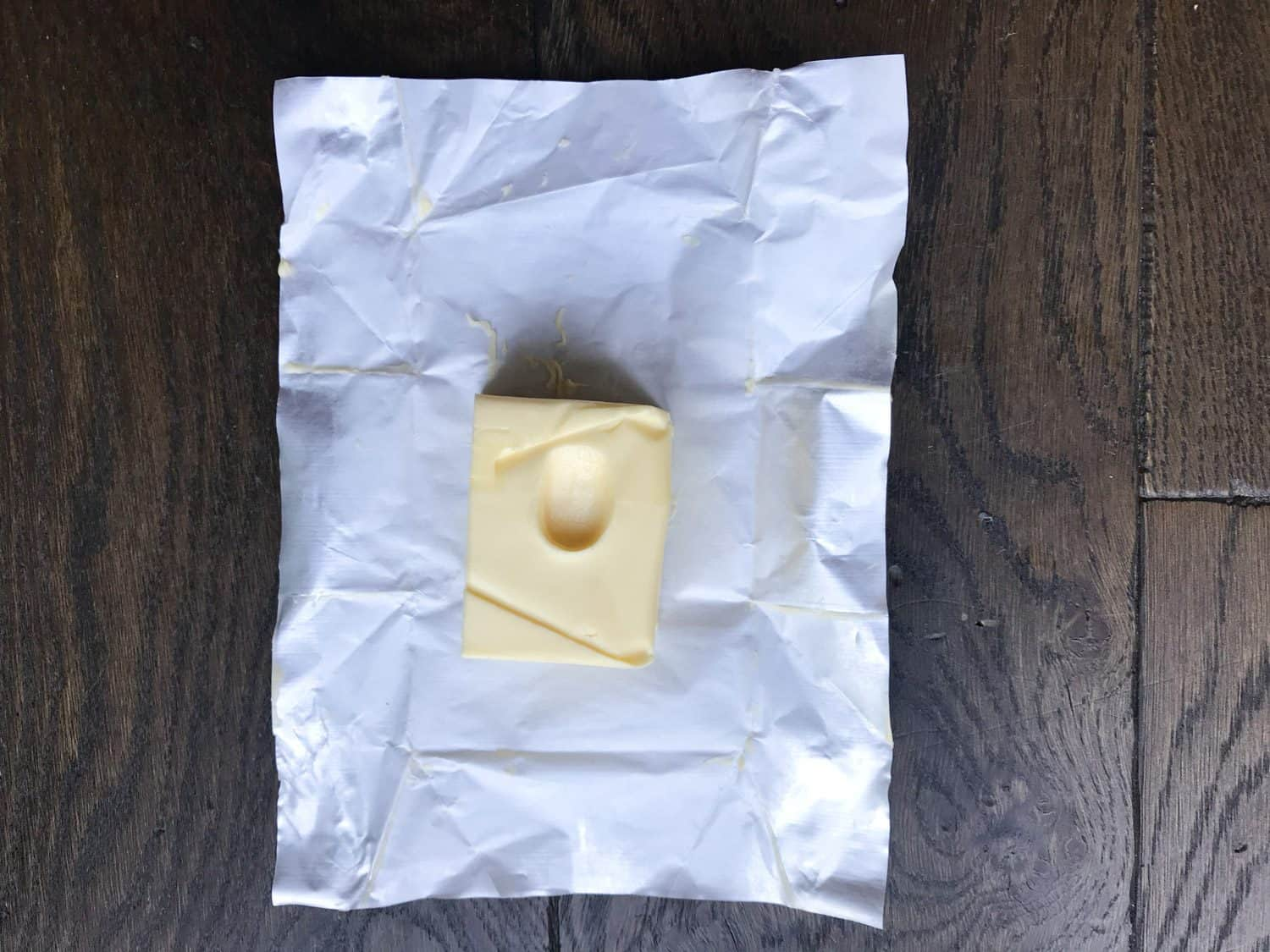 a pat of butter with a fingerprint in the centre