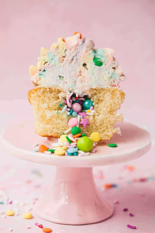 Piñata Cupcakes with Rainbow Icing