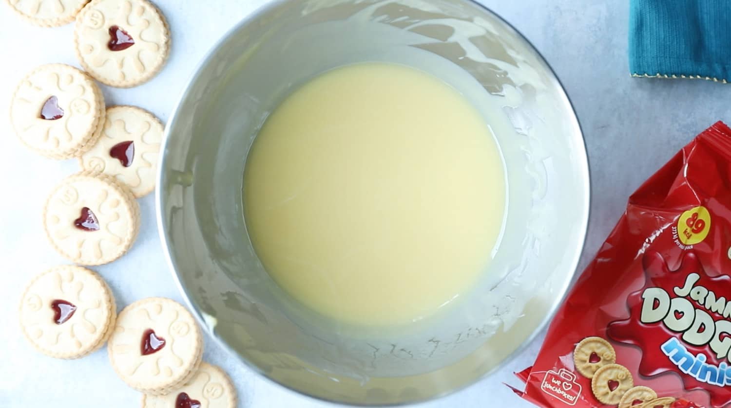 A mixing bowl with melted white chocolate and butter