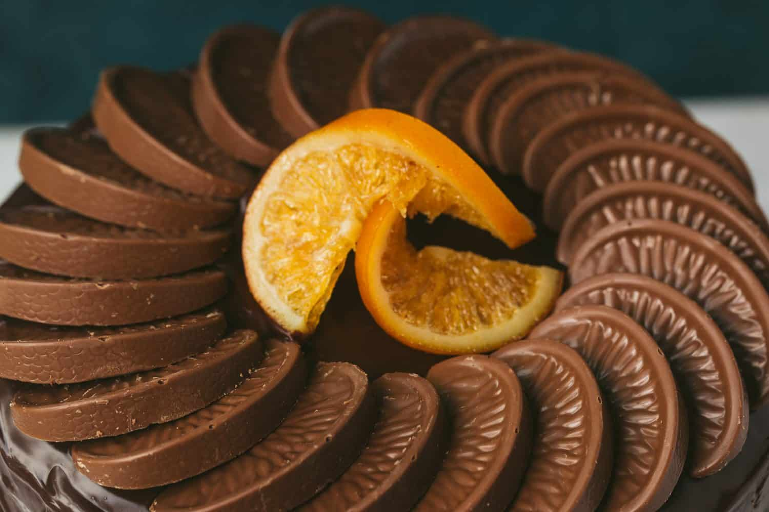 A circle of Terry's chocolate orange segments with 2 candied orange slices in the middle.