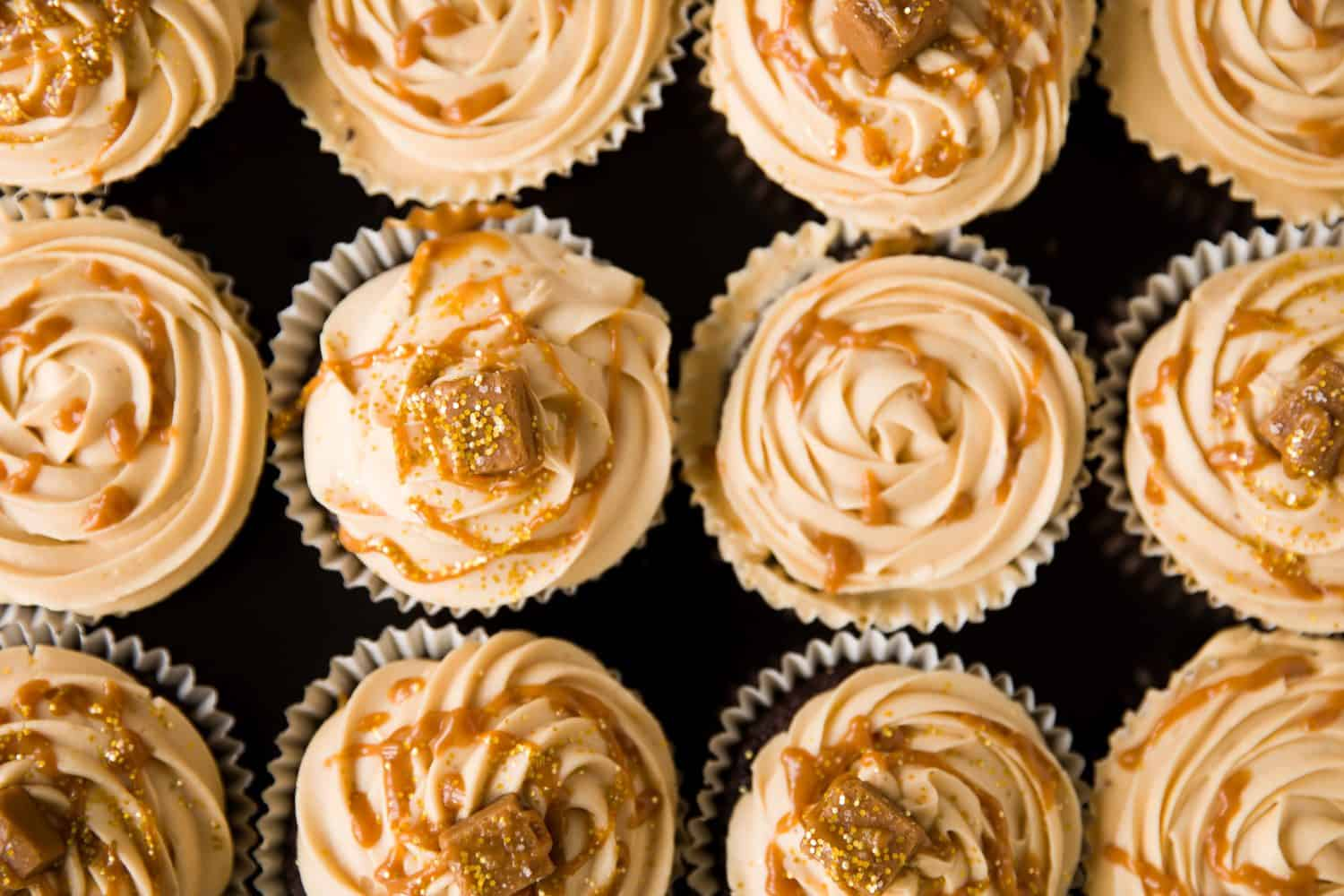 Overhead view of 12 cupcakes in rows of three.