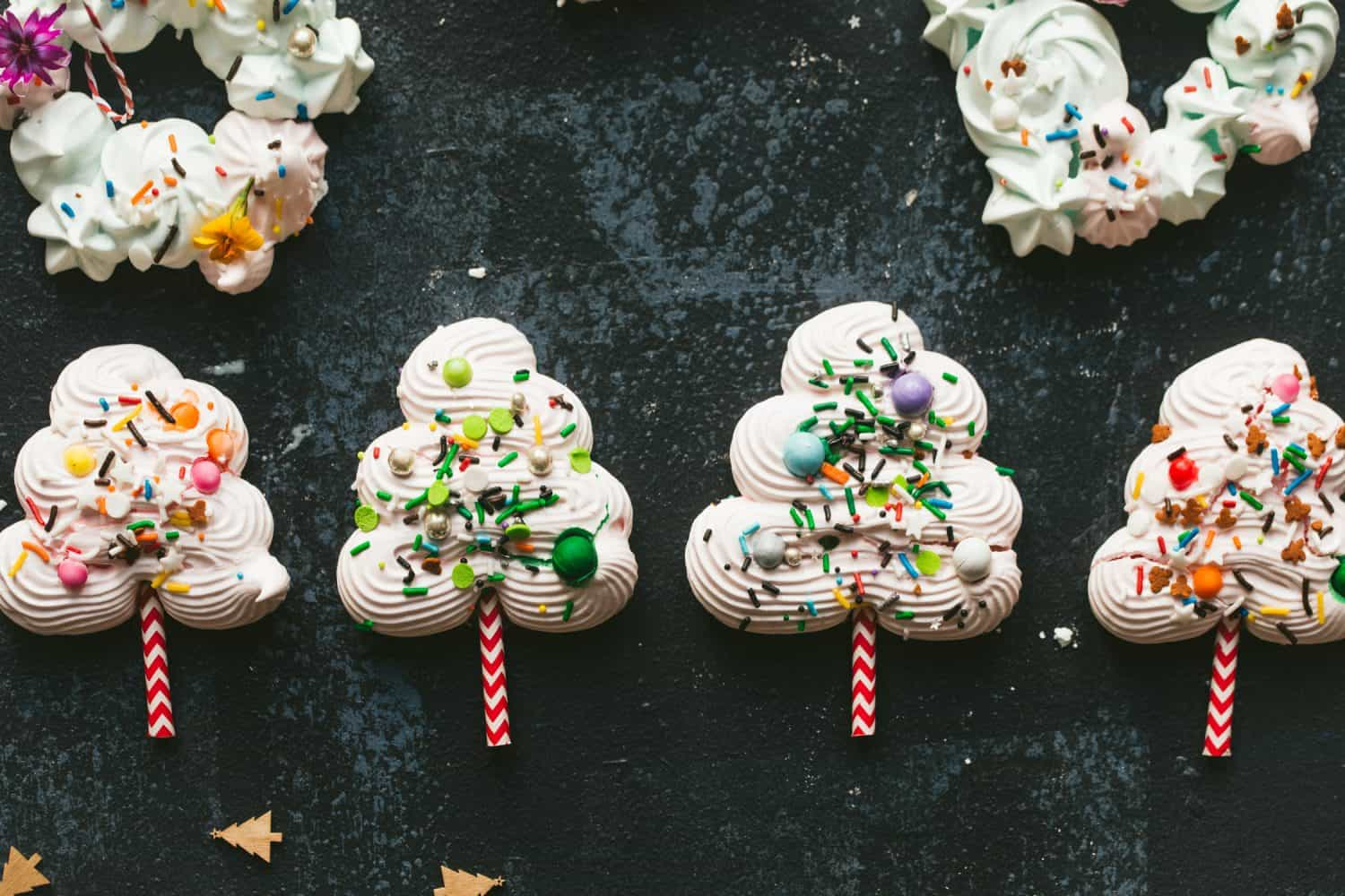 A row of four meringues in the shape of trees.