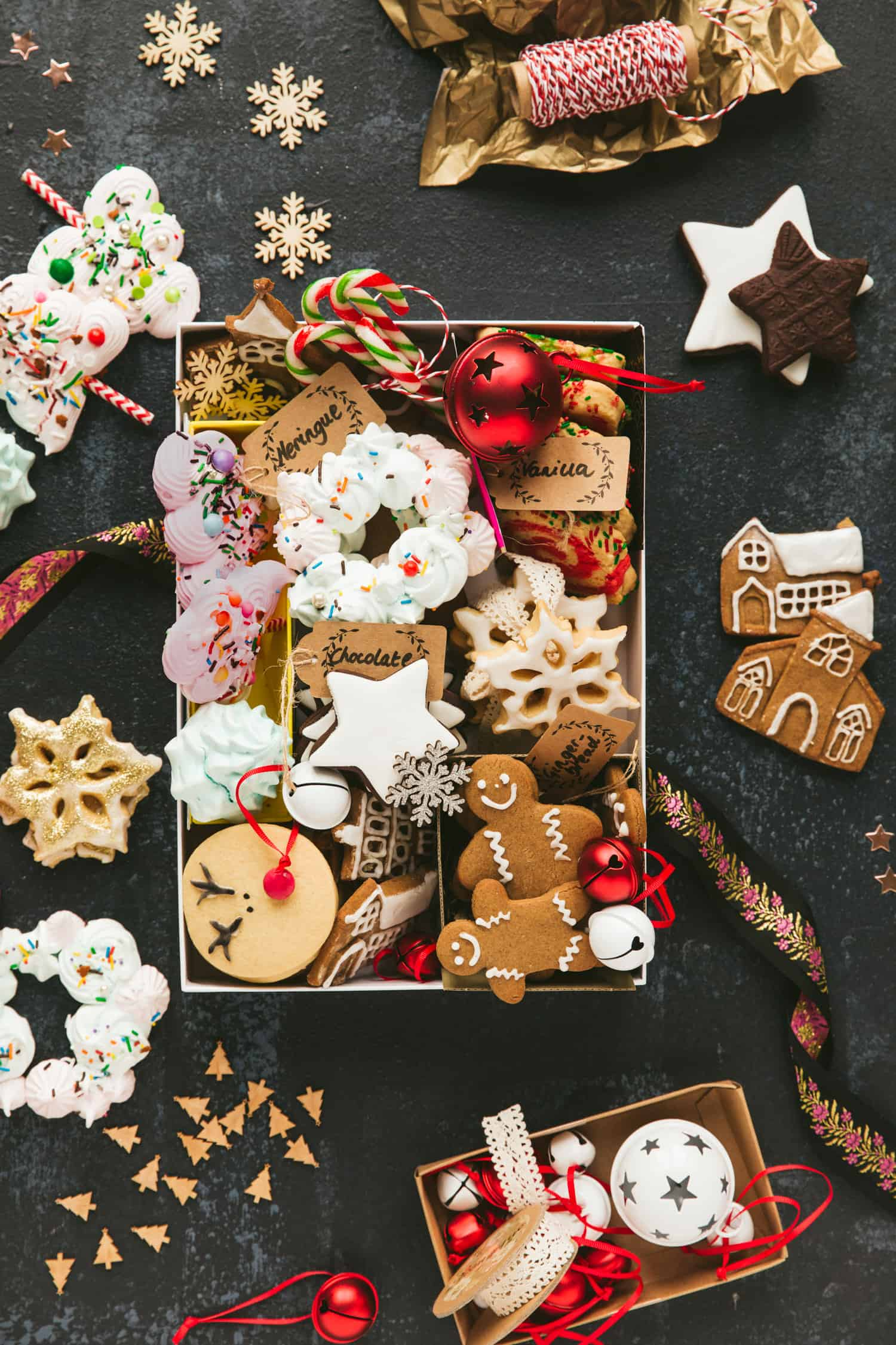 A box containing a variety of Christmas cookies: gingerbread, vanilla, chocolate and pinwheel biscuits.