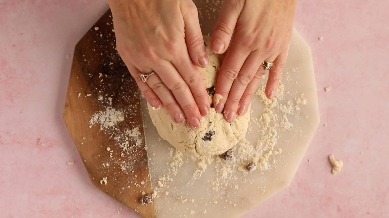 Kneading dough with fingertips.