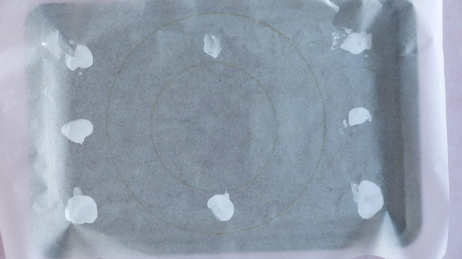 A tracing of a wreath shape on baking paper.