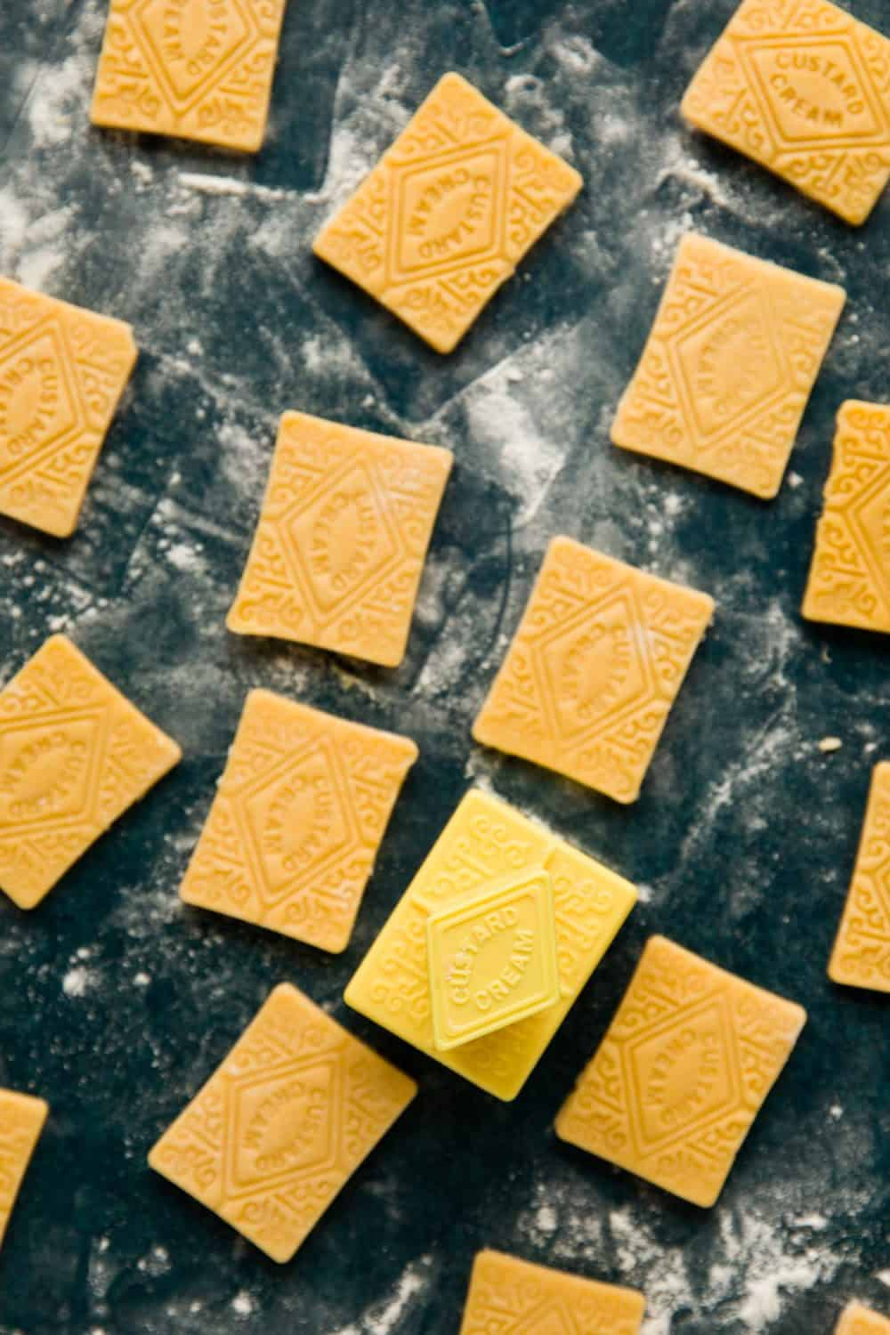 Biscuit dough that has bee printed with a Victorian custard cream pattern.