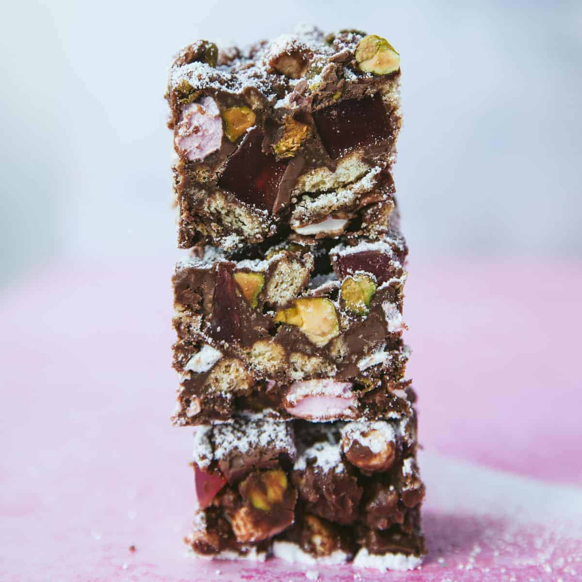 Three pieces of Rocky Road stacked on top of eachother.