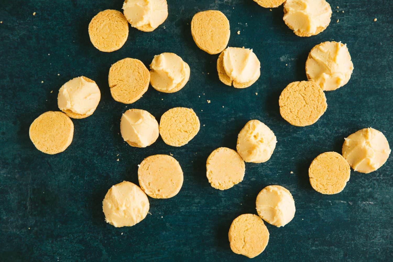 Open custard cream round biscuits.