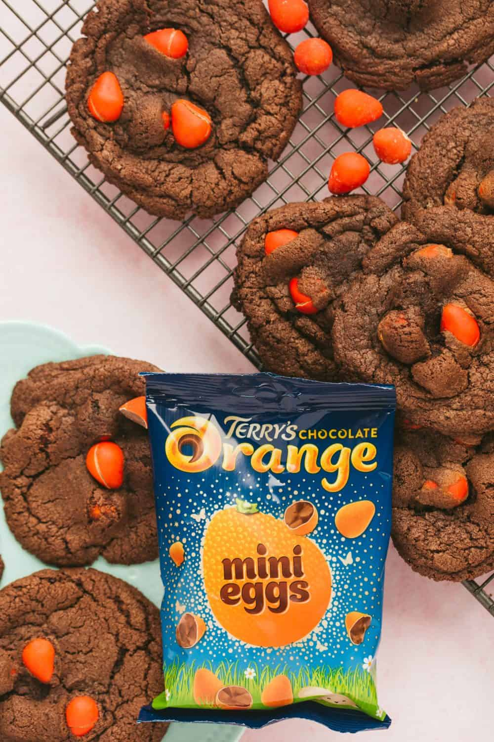 large chocolate mini egg cookies with Easter chocolate inside. Visible is a bad of Terry's chocolate orange mini eggs.