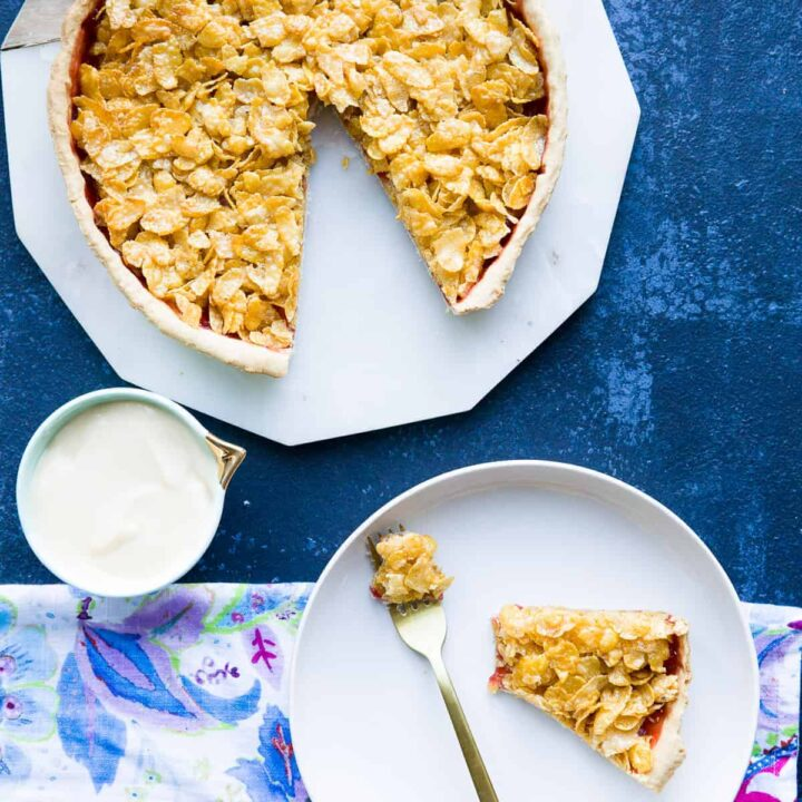 A cornflake tart with a slice cut out.