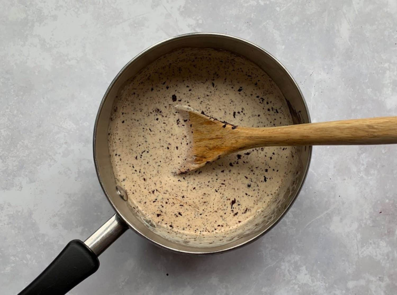 Cream and chocolate in a saucepan.