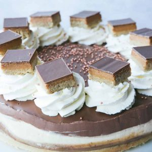 A Millionaire's Cheesecake with slices of Millionaire shortbread on top.