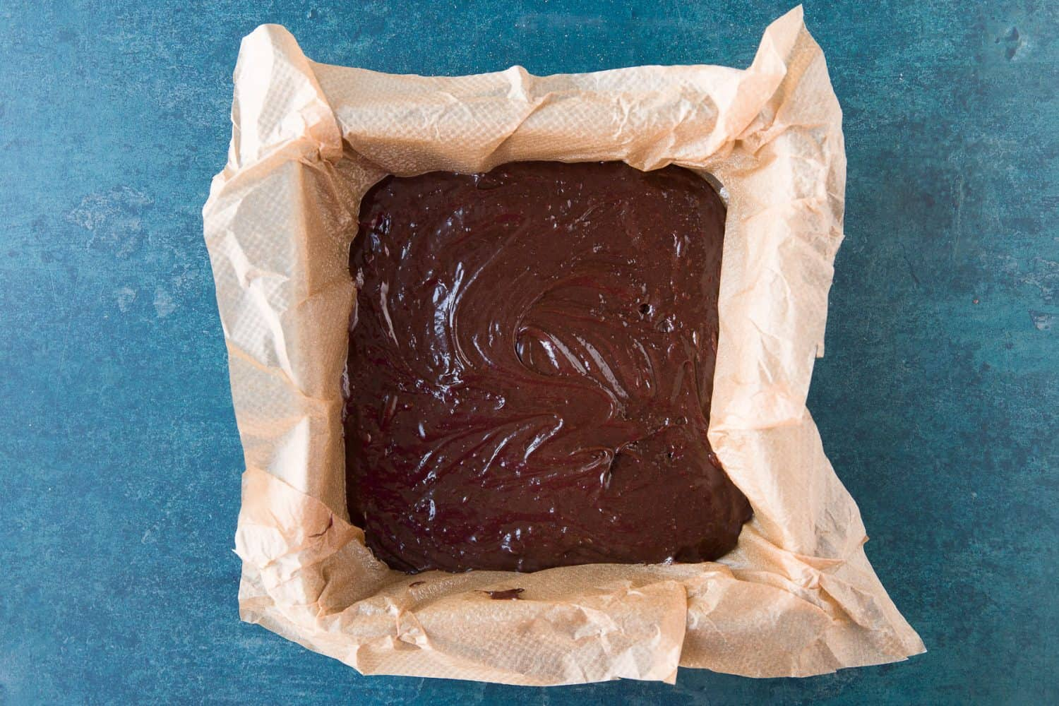 Brownie mixture in a square tin.