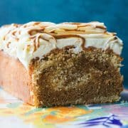 A Biscoff cake with a slice cut out to reveal marbling effect inside.