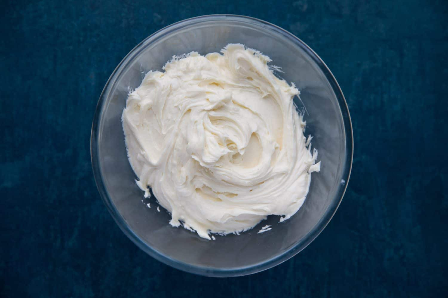 A bowl full of white chocolate buttercream frosting.