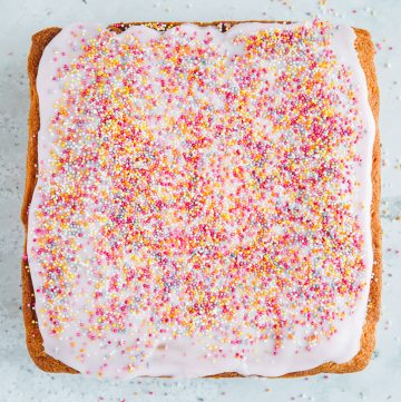 Tottenham Cake covered in pink icing and hundreds and thousands.