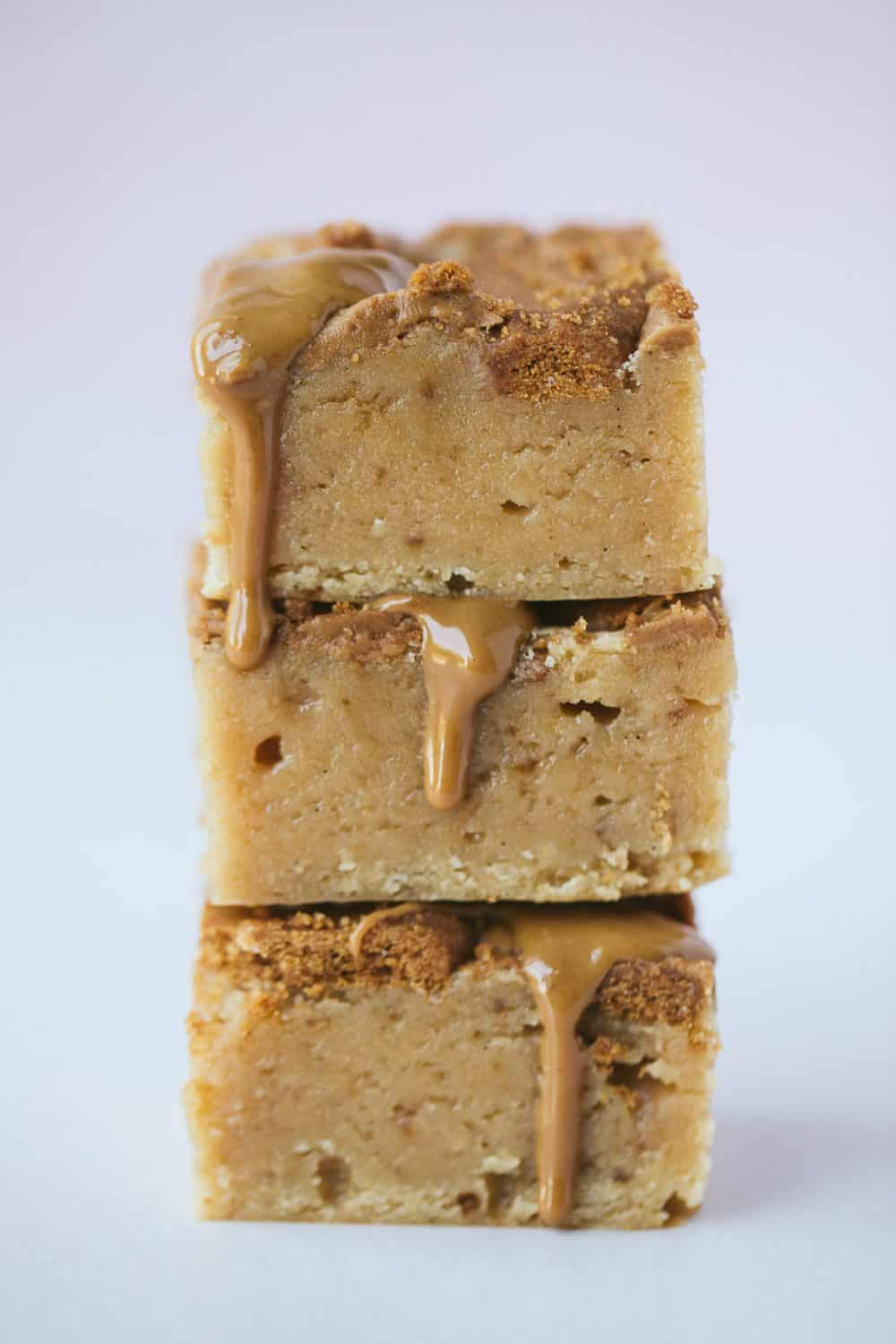 A stack of three Biscoff Blondies with Biscoff spread oozing down the sides.