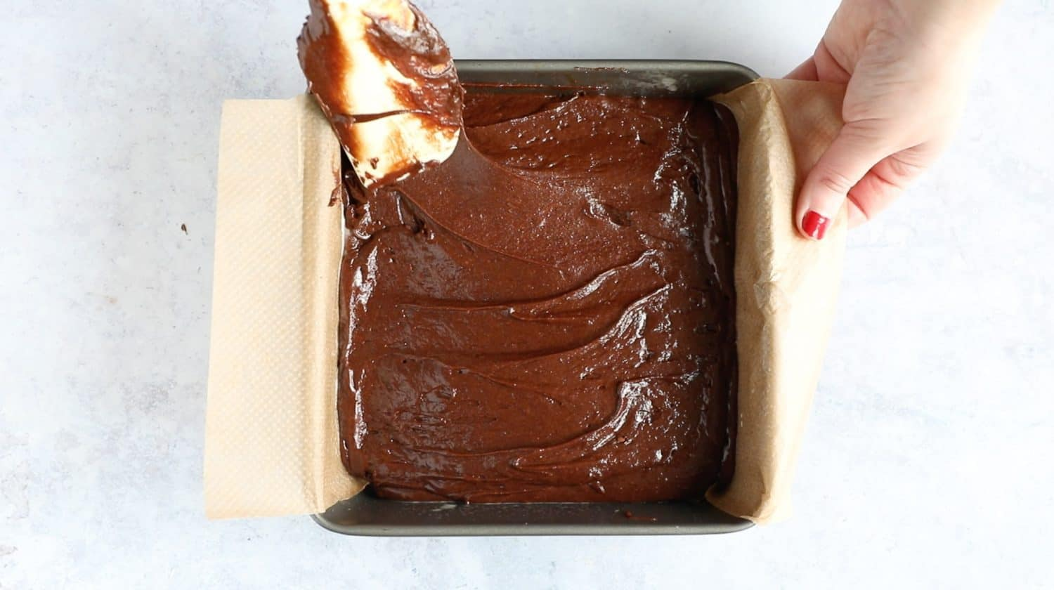 A baking tin filled with brownie batter.