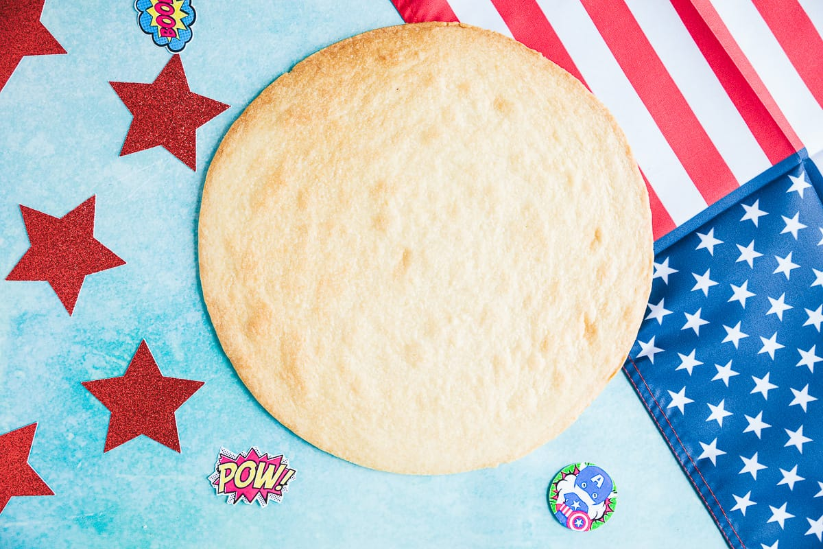A large shortbread circle with an American flag in the background.