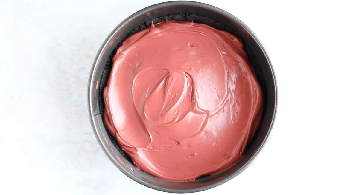 A 20cm springform tin filled with no-bake cheesecake.