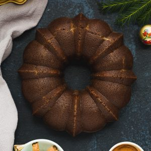 A Gingerbread Bundt Cake on a dark blue background.