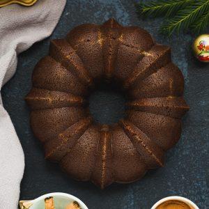 A Gingerbread Bundt Cake on a dark blue background.