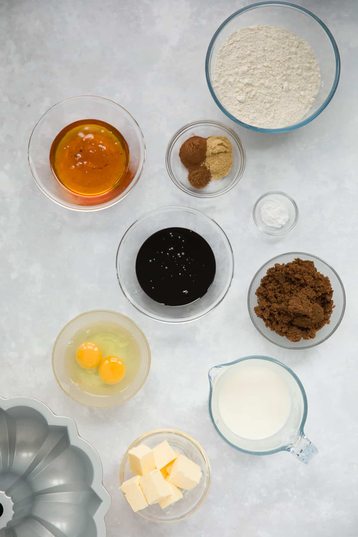 The ingredients needed for making a gingerbread bundt cake.