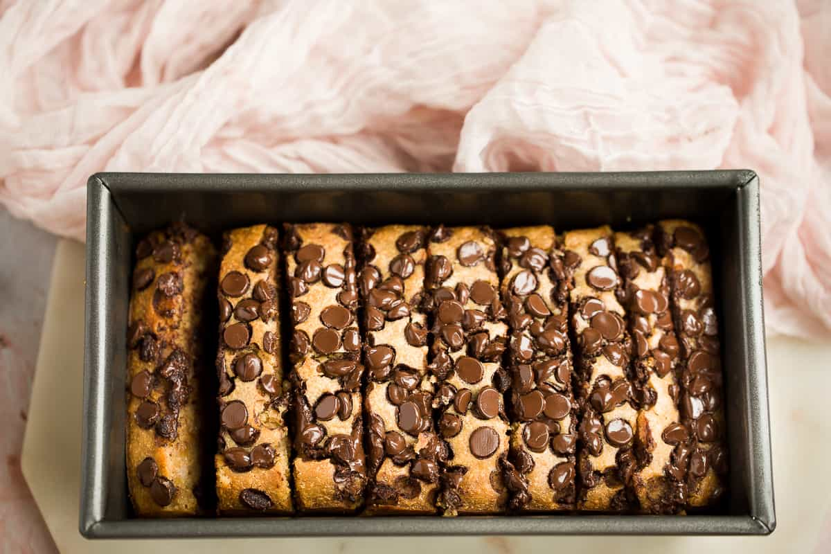 A banana loaf with dark chocolate chips and walnuts.