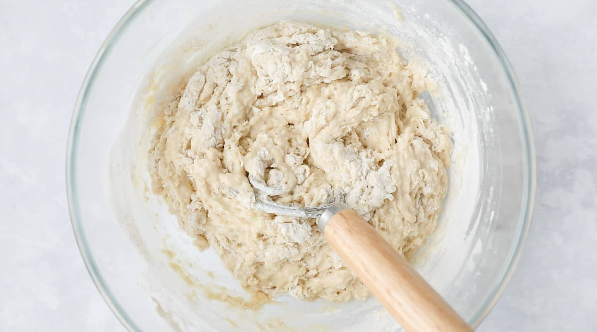 A mixing bowl containing dough.