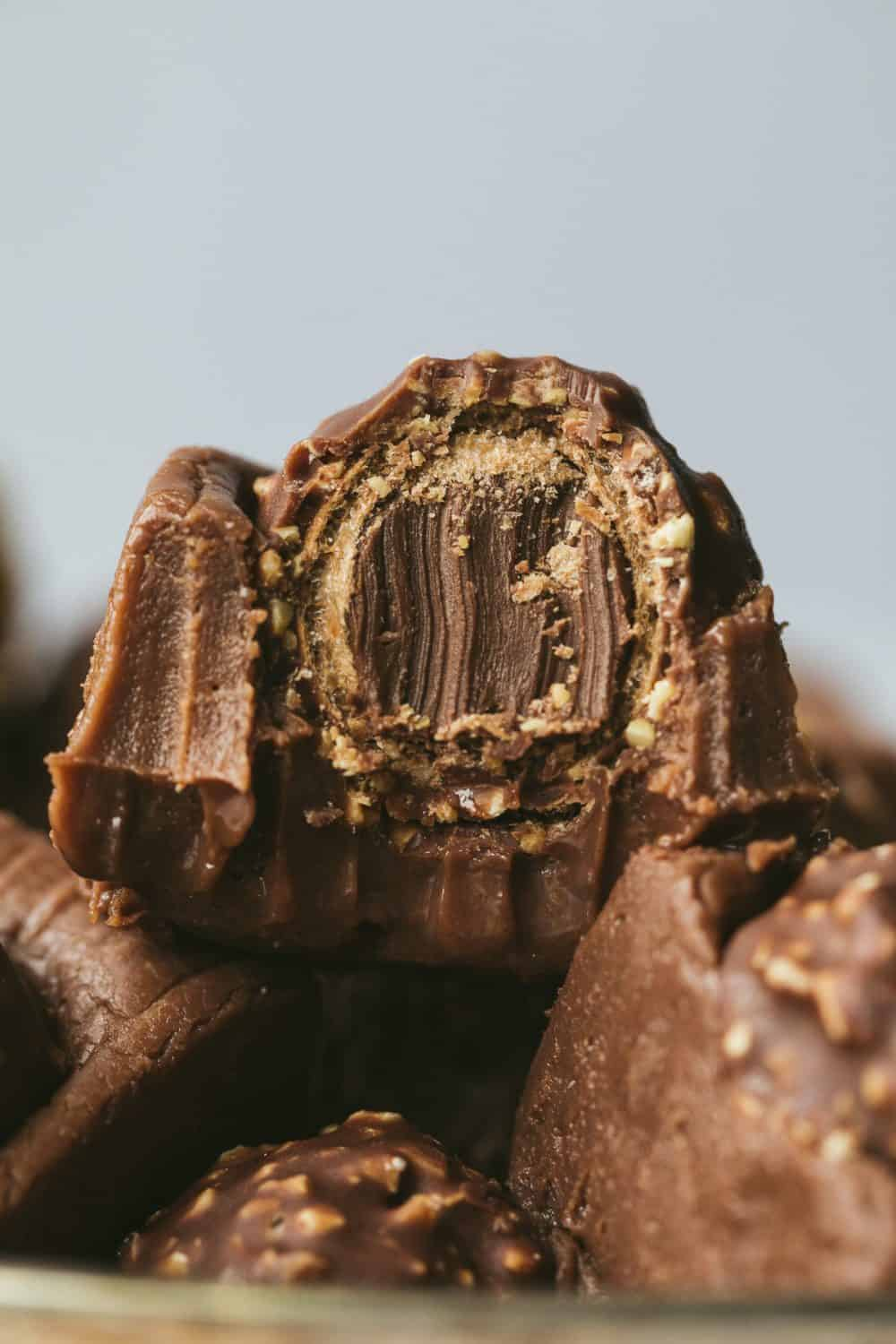 A very close up image of a piece of fudge that has had a bite taken out of it. Teeth marks are visible.