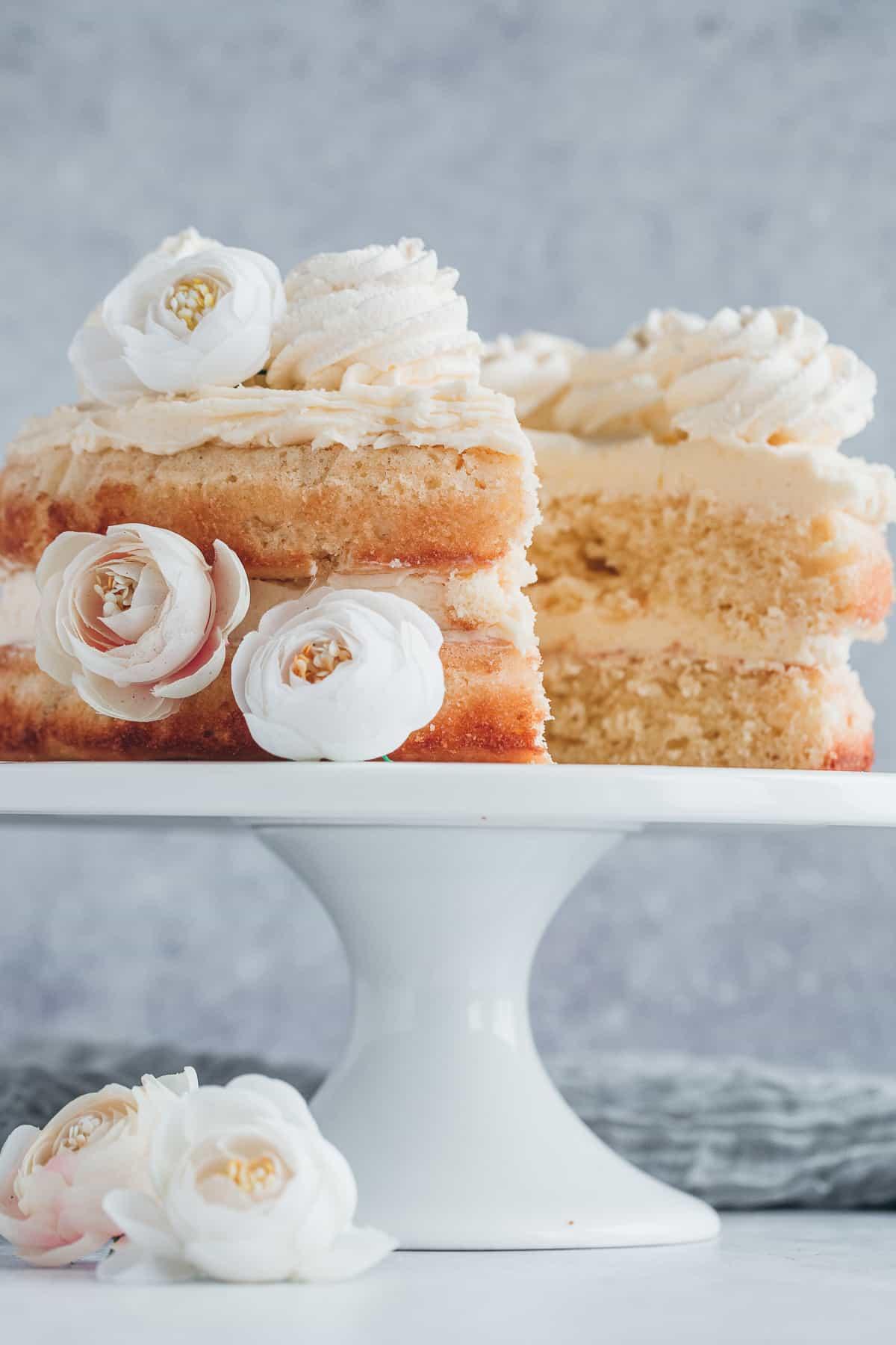 Lemon sponge cake with a slice cut out.