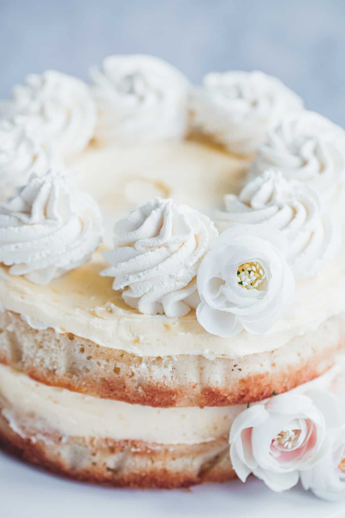 A cake frosted with lemon buttercream.