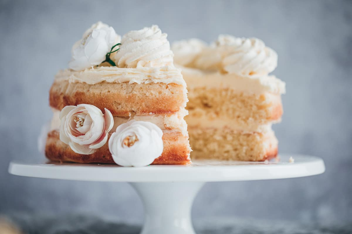"""An 8"""" two layer cake that has had a slice cut away."""