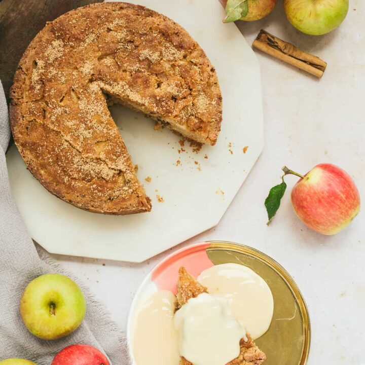 A Dorset Apple Cake with a slice taken out.