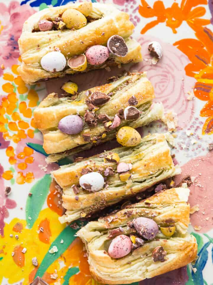 A mini egg puff pastry braid cut into four slices.