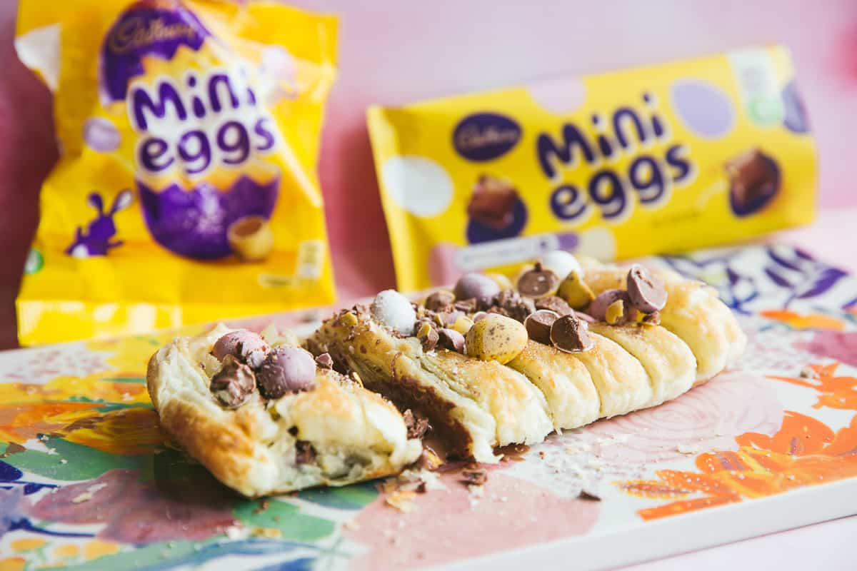 An Easter breakfast pastry covered with cadbury chocolate.