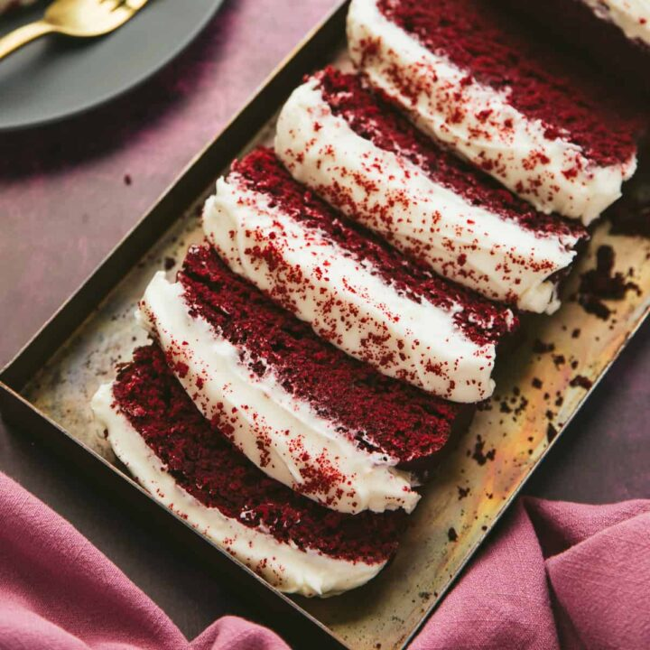 Red Velvet Loaf Cake cut into slices.