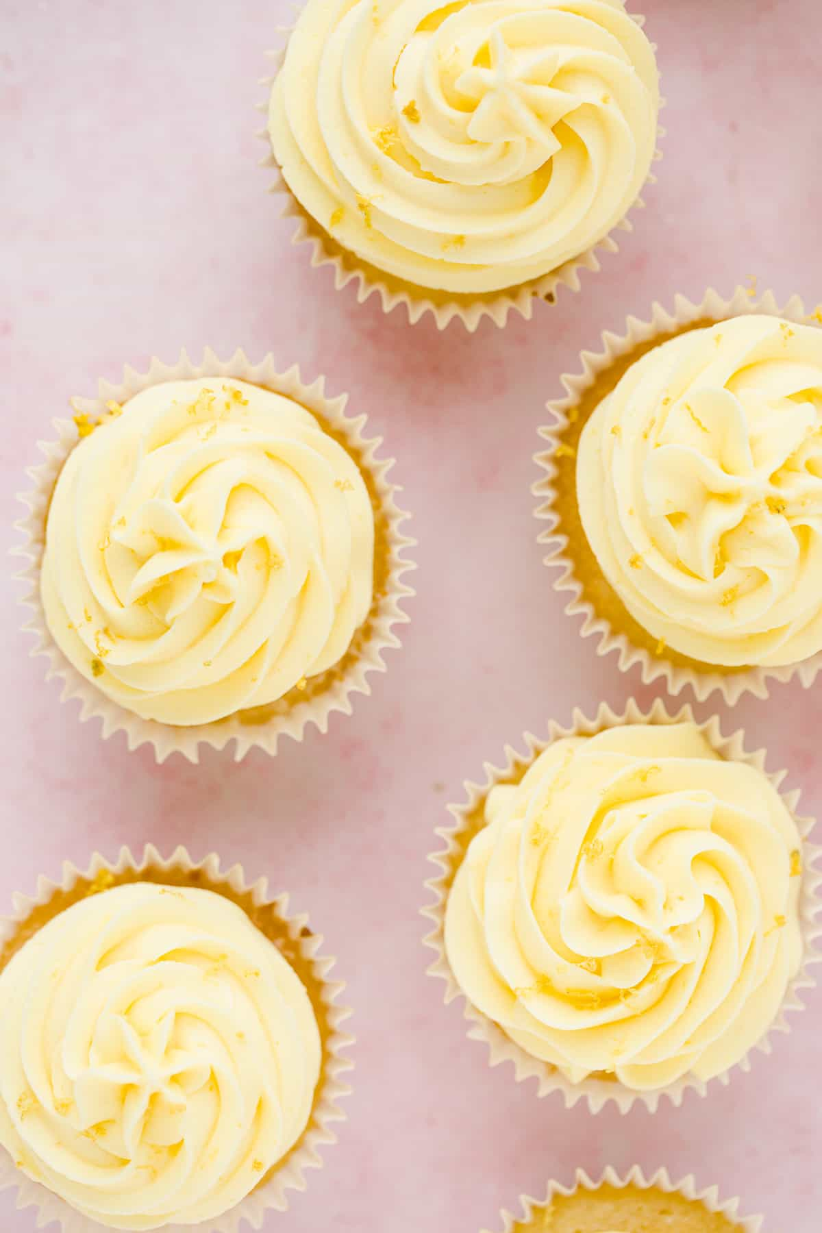 Overhead view of zesty moist lemon drizzle cupcakes.