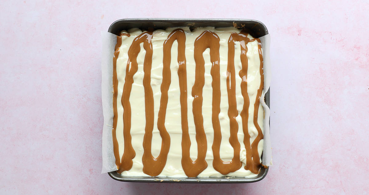 A caramel coloured spread added on top of melted chocolate.