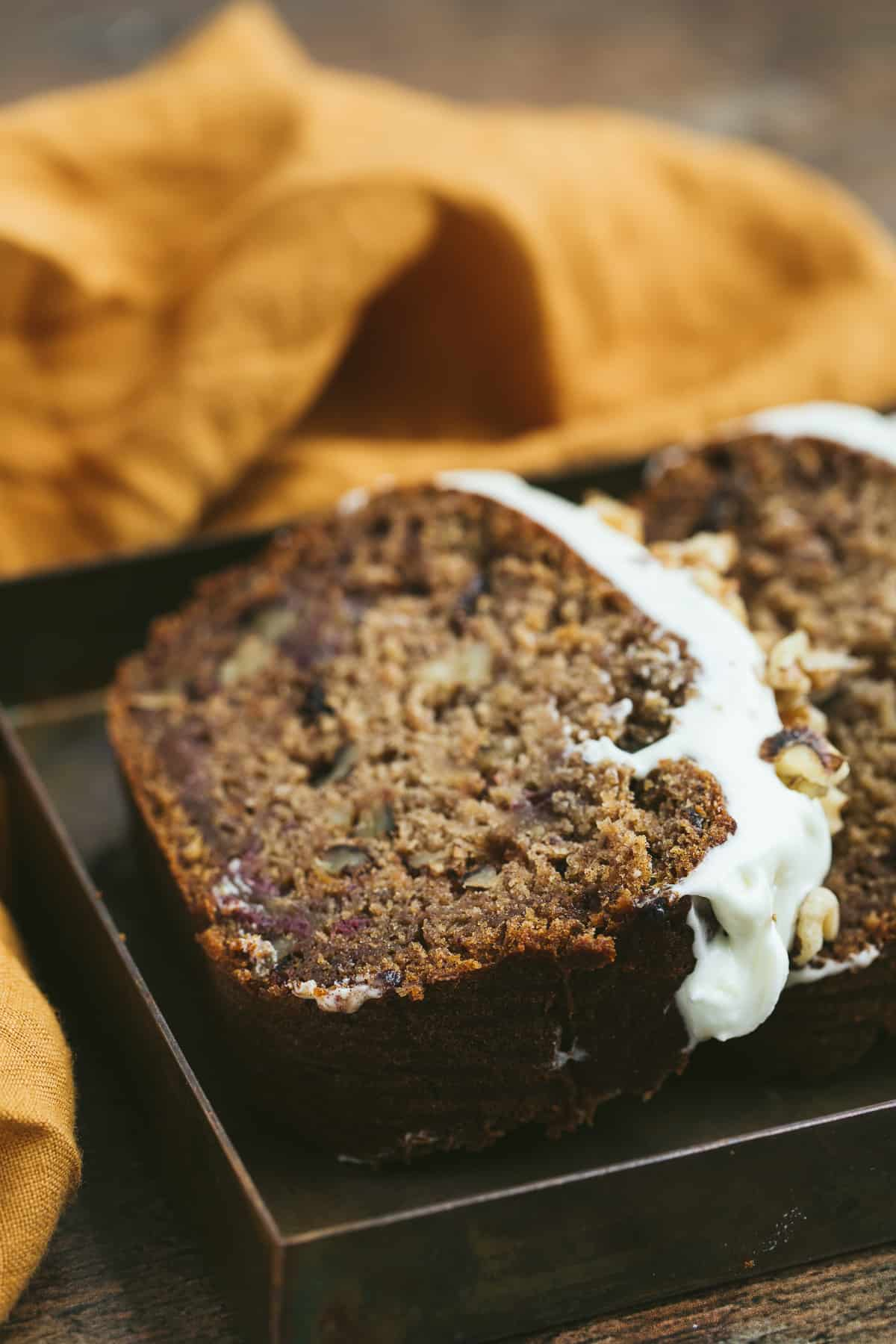 A slice of healthy date and walnut cake.