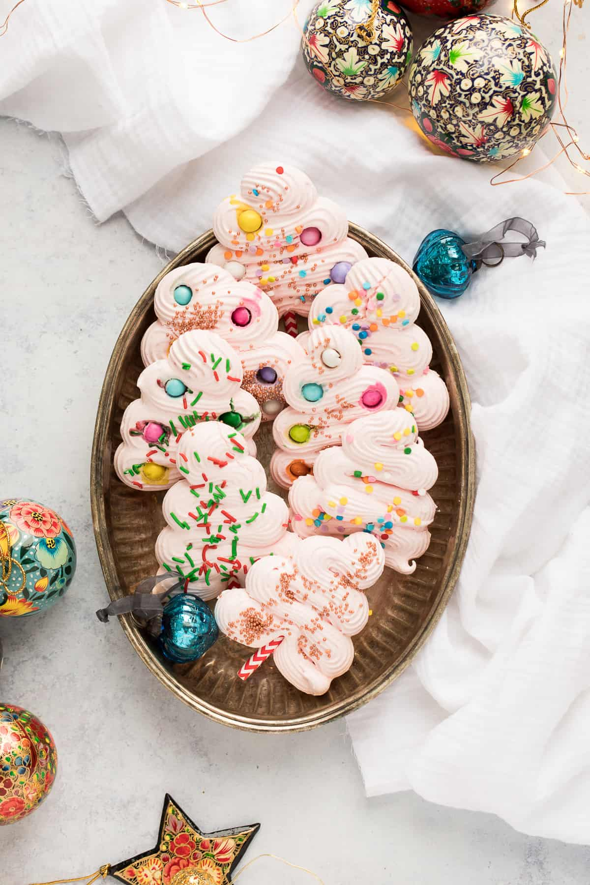 Meringue tree cookies in an oval shaped tray.